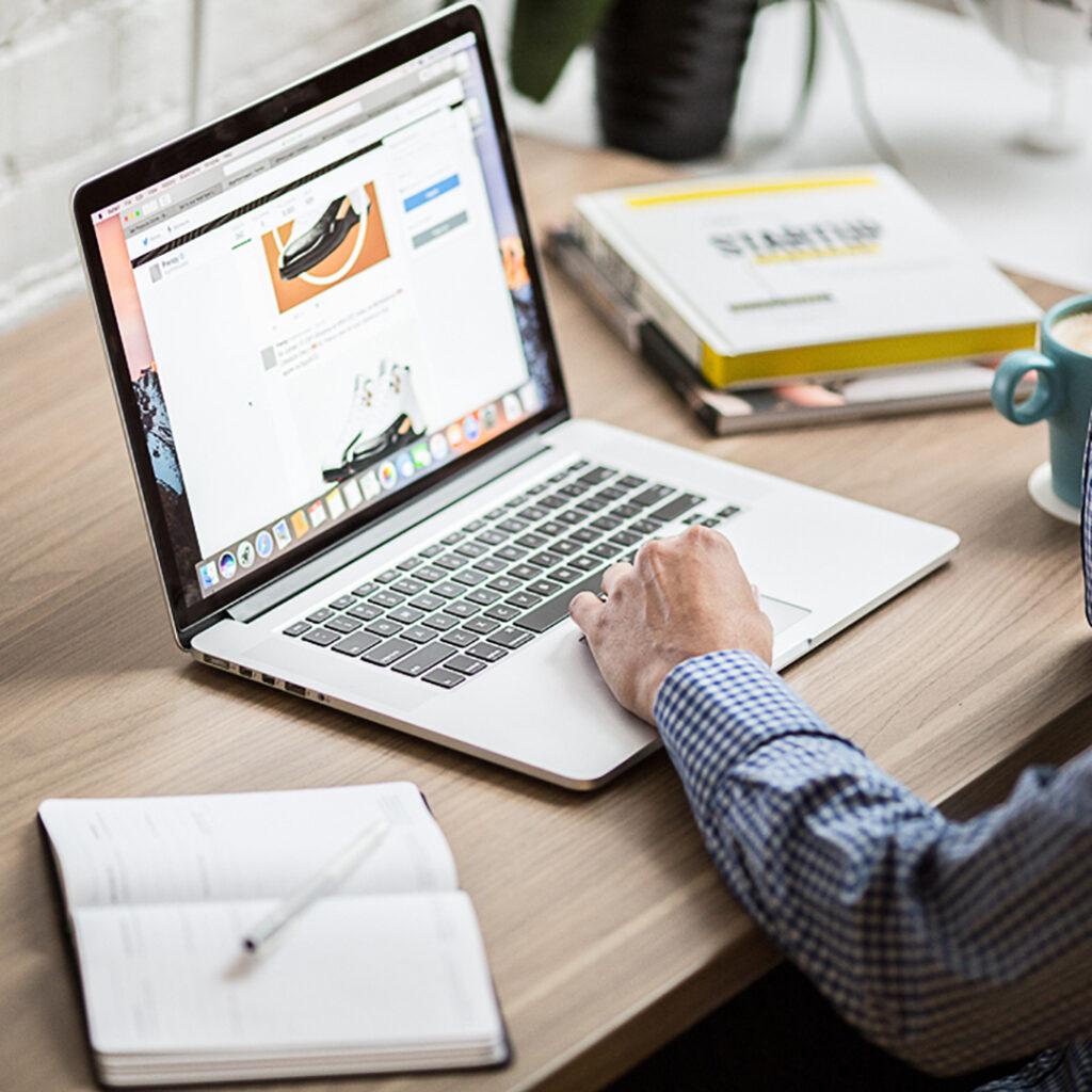 man working at laptop