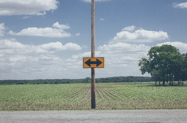 sign in the road to go left or right