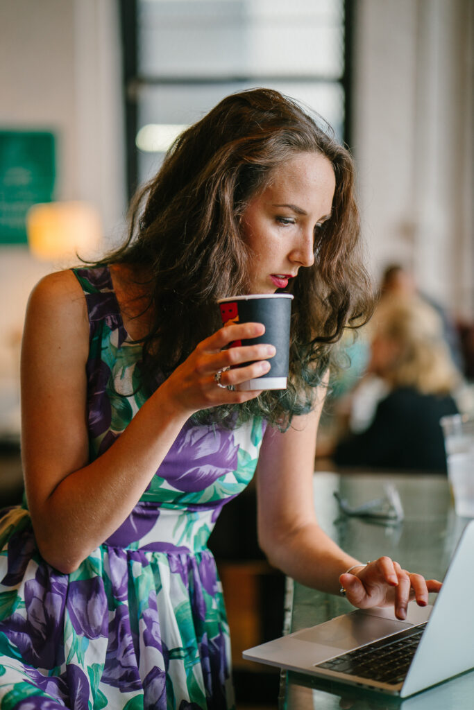 woman with coffee on laptop