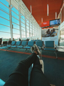 person sitting alone in an airport terminal